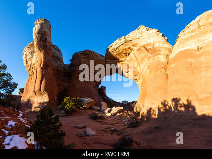 Feature known as Broken Arch with blue sky in the background - Stock Photo