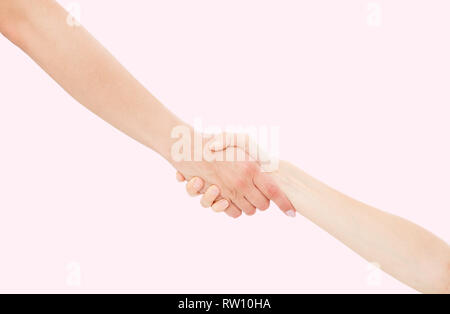 Giving a helping hand isolated on pink background, female hand