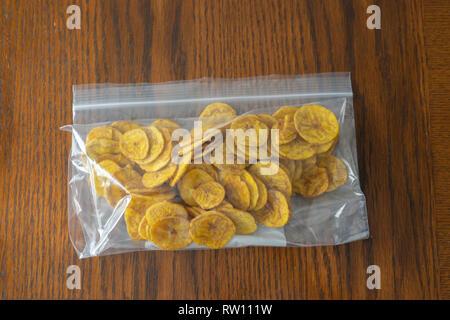 Nigerian Plantain Chips kept fresh in plastic bag - Stock Photo