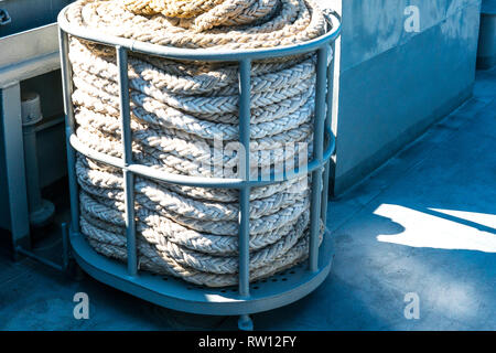 Bay of old hemp rope on a warship - Stock Photo