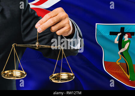 Judge is holding golden scales of justice with Montserrat waving flag background. Equality theme and legal concept. - Stock Photo