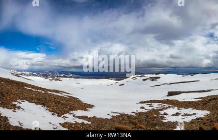 Panoramic view of Askja caldera with stormy clouds raining over the Herdubreid tuya mountain in background, Highlands of Iceland, Scandinavia - Stock Photo