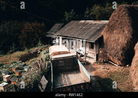 A small house house in village with a truck - Stock Photo