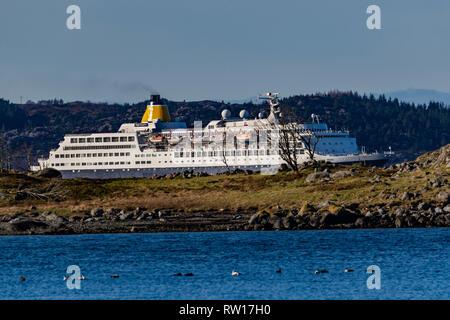 Cruise ship Saga Sapphire passing through narrow fjords on way to port of Bergen, Norway - Stock Photo