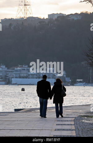 Lovers walking at Rumeli Fortress Seaside in Bosphorus, Istanbul, Turkey. - Stock Photo