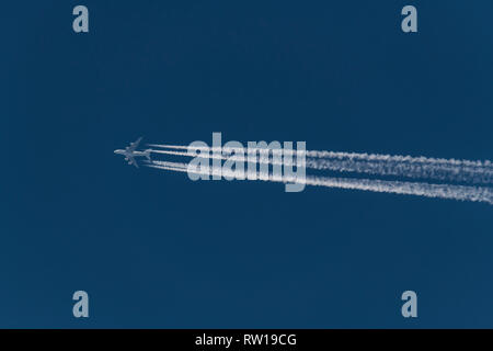 Airbus A380, double-deck, wide-body, four-engine jet airliner flying at altitude with contrail from the four engines, Air France aircraft - Stock Photo
