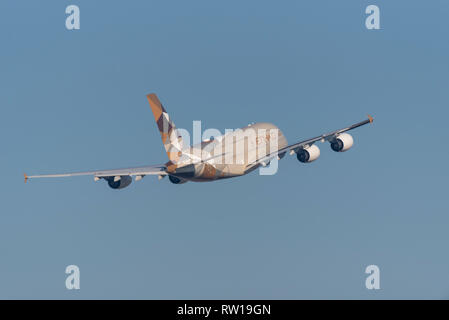 Etihad Airways Airbus A380 superjumbo jet airliner plane A6-APC taking off from London Heathrow Airport, UK, in blue sky. Space for copy - Stock Photo