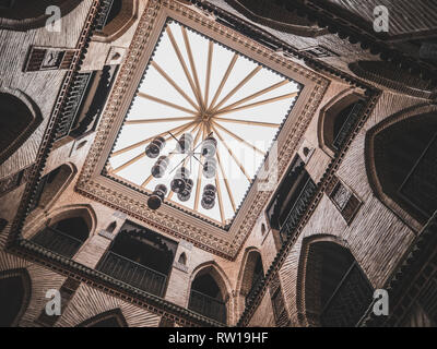 MARRAKESH, MOROCCO - March 27, 2018: Looking up a traditional moroccan riad in the medina of Marrakesh - Stock Photo