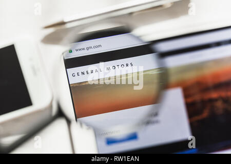 New York, USA - 4 March 2019: General Motors Company, GM official website homepage under magnifying glass. General Motors Company, GM logo visible - Stock Photo