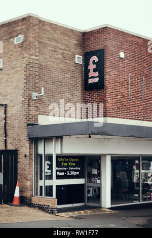 Harwich & Dovercourt, Essex, ENGLAND - March 3, 2019: Frontage to a pound shop in Harwich High Street with an abandoned traffic cone to the left. - Stock Photo