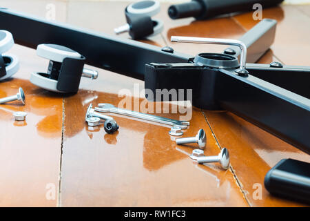 Still life shot of assembly of DIY chair furniture. Close-up shot, screwing path of chairs with hex key of DIY Chair furniture. - Stock Photo