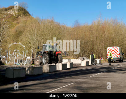 Stoney Wood, Wirksworth, Derbyshire Dales, UK. 4th March, 2019. Workmen at the local beauty spot Stoney Wood carpark as Derbyshire Dales District Council try relocating a Gypsy Roma Travellers camp on land adjacent to Stoney Wood.Wirksworth Town Council are seeking legal advise to try & protect the trees, rare wild orchids & other wildlife in and around this Sight of Special scientific Interest. Credit: Doug Blane/Alamy Live News - Stock Photo