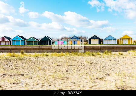 Sutton On Sea, Lincolnshire, UK. 04th Mar, 2019. UK Weather: 04/03/19 Bright, sunny but very windy day sand dunes of Sutton On Sea, Lincolnshire, East coast, UK England. Clouds forming over the Chalets lining the sea front. beach chalet, beach chalets, sutton on sea chalets, colourful Credit: Tommy  (Louth)/Alamy Live News - Stock Photo
