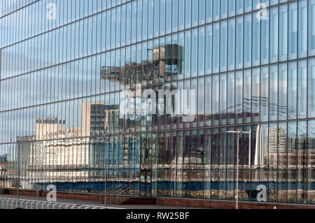Glasgow, Scotland, UK. 4th March, 2019. UK Weather: Reflections in the windows of the BBC Scotland building on the banks of the River Clyde at Pacific Quay on a sunny afternoon. Credit: Skully/Alamy Live News - Stock Photo