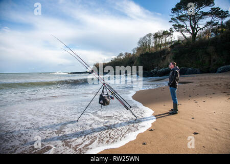 Myrtleville, Cork, Ireland. 04th March, 2019. After the passing of Storm Freya the weather cleared and allowed John Keenan from Passage West to go fishing for Dogfish on the beach at Myrtleville, Co. Cork, Ireland Credit: David Creedon/Alamy Live News - Stock Photo