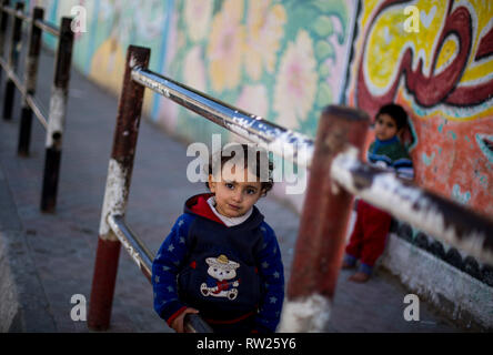 Gaza, Palestine. 4th Mar 2019. A Palestinian girl seen standing near their house at the Jabalya refugee camp in the northern Gaza Strip. With high rates of unemployment and lack of job opportunities in Gaza, an increasing number of families are facing poverty after losing work during the last 12-year blockade on Gaza. Credit: SOPA Images Limited/Alamy Live News - Stock Photo