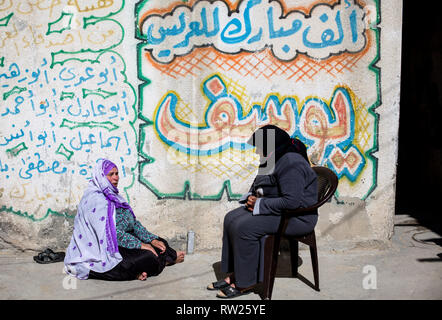 Gaza, Palestine. 4th Mar 2019. Palestinian women are seen seated at their home in the Jabalya refugee camp in the northern Gaza Strip. With high rates of unemployment and lack of job opportunities in Gaza, an increasing number of families are facing poverty after losing work during the last 12-year blockade on Gaza. Credit: SOPA Images Limited/Alamy Live News - Stock Photo