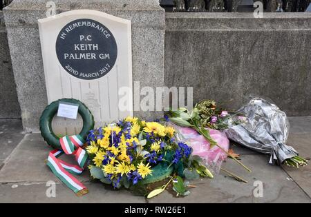 4th Mar 2019. Bouquets continue to be laid at the new memorial to PC Keith Palmer as we approach the second anniversary of his death in the Westminster Bridge Terror Attack on 22.03.2017.Houses of Parliament,Westminster,London.UK Credit: michael melia/Alamy Live News - Stock Photo