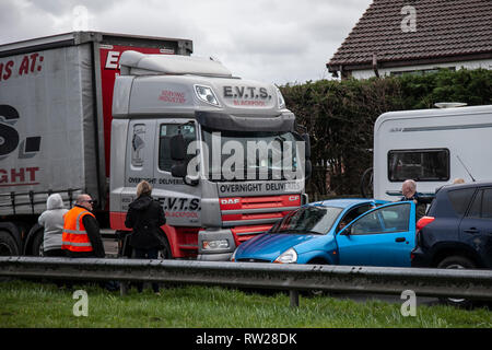 Southport, Merseyside. 4th March, 2019. TRC on the A565 Gravel lane roundabout between DAF heavy goods vehicle and small Ford compact family car which ended up being pushed sideways down the road. Credit: Media World Images/Alamy Live News - Stock Photo