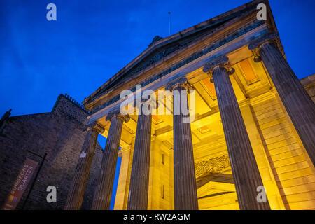 Lights illuminate front exterior of Surgeons Hall Museum at night, Edinburgh, Scotland - Stock Photo