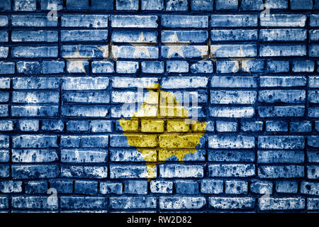 National flag of Kosovo on a brick background. Concept image for Kosovo: language , people and culture. - Stock Photo