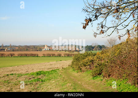 A public footpath and circular walk with views to Morston from the Downs in North Norfolk at Blakeney, Norfolk, England, United Kingdom, Europe. - Stock Photo