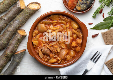 Tripes in clay pot. Top view. Rustic appearance. (Callos a la Madrileña). - Stock Photo