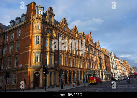 London, England - February 28, 2019: Classic buildings at Wigmore Street in the westend in late sunlight - Stock Photo