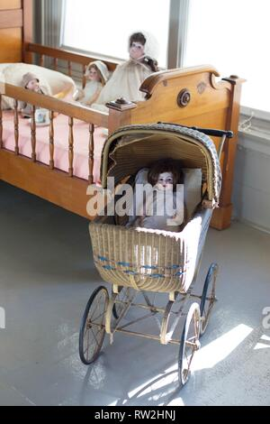 Dolls in a child's room on display at Pittock Mansion in Portland, Oregon, USA. - Stock Photo