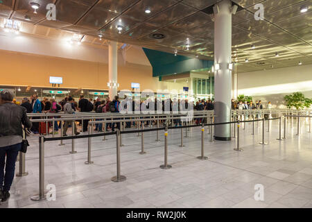Long queue at passport control in the international arrivals terminal, Cape Town International Airport, for entry into South Africa. Travel, tourism,  - Stock Photo