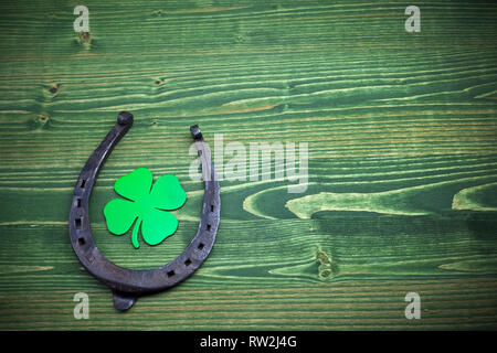 St. Patricks day, lucky charms on green wooden background - Stock Photo