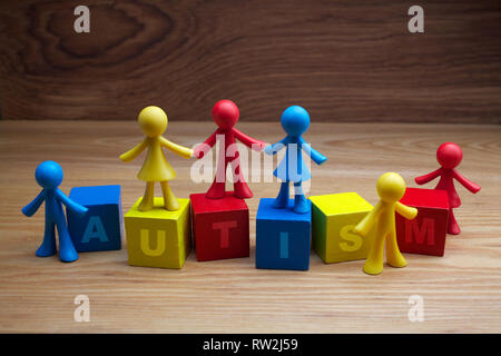 Doll children background design with autism word on cubes - Stock Photo