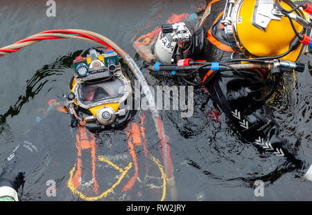 Trainee divers practise their skills in all aspects of the trade from welding to diving plus buddying.Fort William Scottish Highlands Scotland UK - Stock Photo