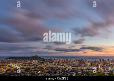 A slow exposure view of Diamond Head and Waikiki from Tantulus lookout. - Stock Photo