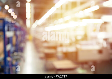 Abstract blurred manufacturing area at factory, industrial background - Stock Photo
