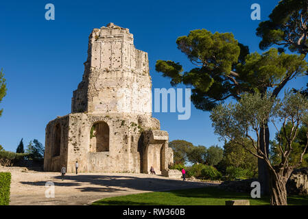 park and ancient ruins of the Tour Magne in Nimes, Provence, France - Stock Photo