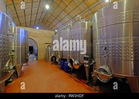 Stainless steel tanks for fermentation in modern Malbec wine factory, San Juan, Argentina, also seen in Mendoza - Stock Photo
