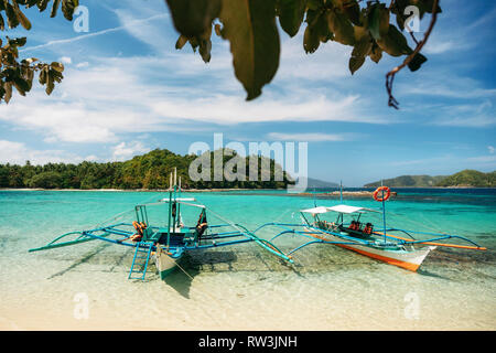 Small bangka boats on beach of Paradise island, Port Barton, Philippines - Stock Photo