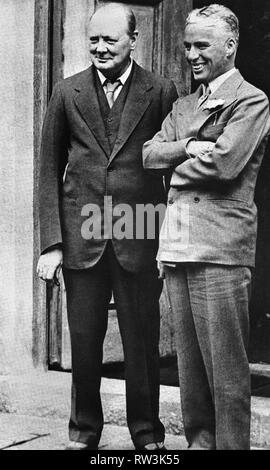 Winston Churchill with Charlie Chaplin on a visit to Chartwell. 1929. - Stock Photo