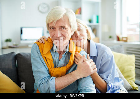 Portrait of mature couple in love embracing tenderly and looking at camera, copy space - Stock Photo