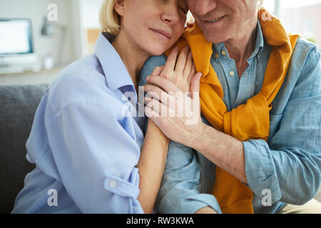 Close up portrait of mature couple in love embracing tenderly - Stock Photo