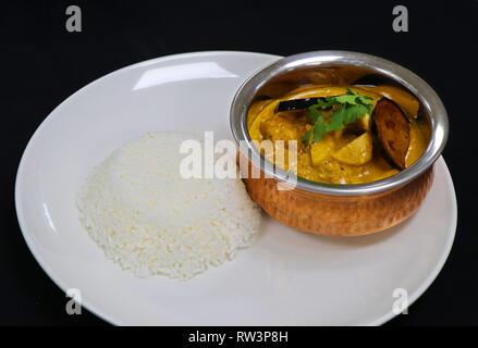 Thai yellow chicken curry with jasmine rice - Stock Photo