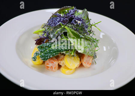 ratte potato and sweet potato salad with lettuce - Stock Photo