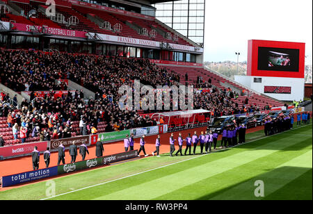 Stoke City fans, players and staff applaud as the Gordon Banks funeral cortege passes through the bet365 Stadium, Stoke. - Stock Photo