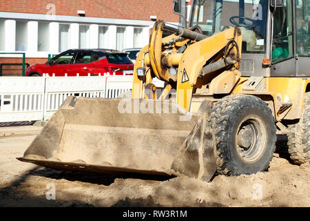 Excavator with excavator bucket on a construction site - Stock Photo