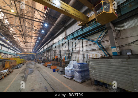 Industrial concept. An overview on construction site inside the manufacturing plate. Lifting cranes - Stock Photo