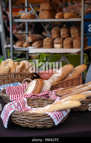 A selection of freshly baked bread on a farmers market bakery stall in Edinburgh, Scotland - Stock Photo