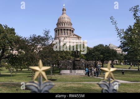 Texas State Capitol in downtown Austin, USA. View from the grounds where The Texas African American History Memorial is located. - Stock Photo