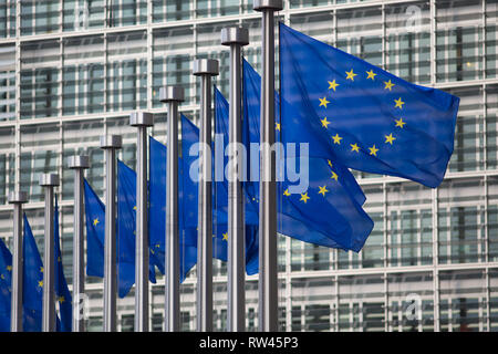 European Union flags in front of Berlaymont building - Stock Photo