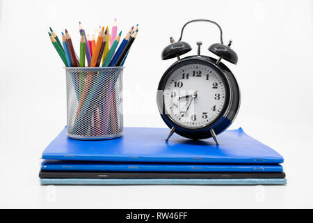 Time for school concept with books, pencils and alarm clock - Stock Photo